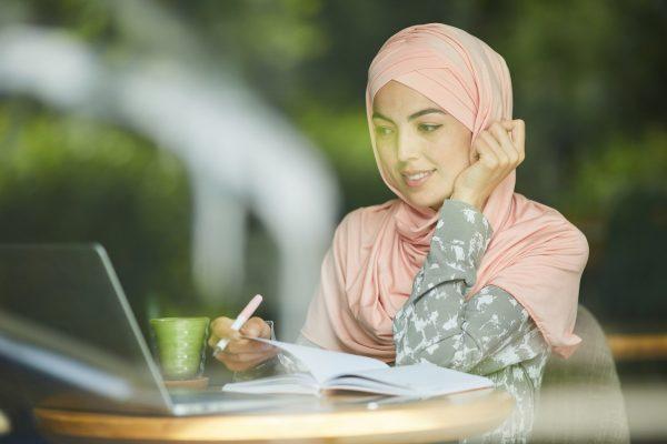 woman-in-hijab-watching-webinar.jpg